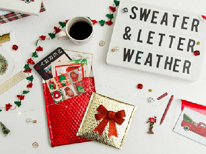 "Gift wrap, coffee, Christmas trees, festive decor, a tab that says ""Sweater & Letter Weather"""